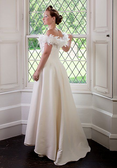 Wedding gown with feathering